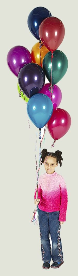 Girl holding multiple colorful balloons